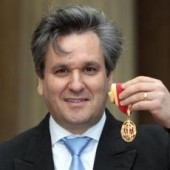 Royal Opera House Music Director, Antonio Pappano, poses with his Knighthood after being knighted by Britain's Prince Charles at Buckingham Palace in London May 15, 2012.