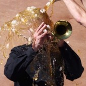 [WATCH] David Lynch Accepts ALS Ice Bucket Challenge But Not Without the Aid of His Trumpet